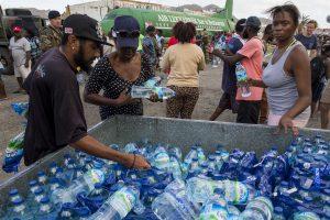 Sint Maarten / Saint Martin: People waiting for fresh drinkgwater